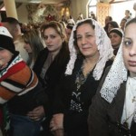 Iraqi women at a church worship.
